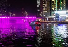 Dubai water canal waterfalls details pricing and location timing